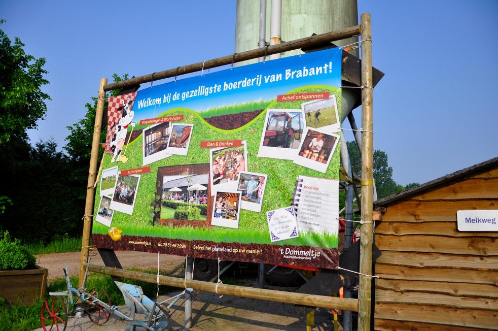 't Dommeltje - Spandoek XL + gevelbord