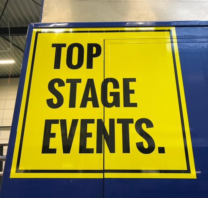 Top Stage Events - Belettering podiumwagen